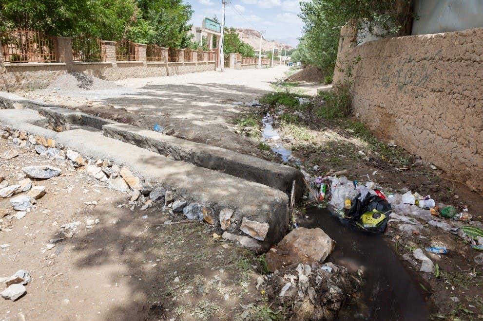 Water drain splitting the road in Bamyan. (Georg Schaumberger)