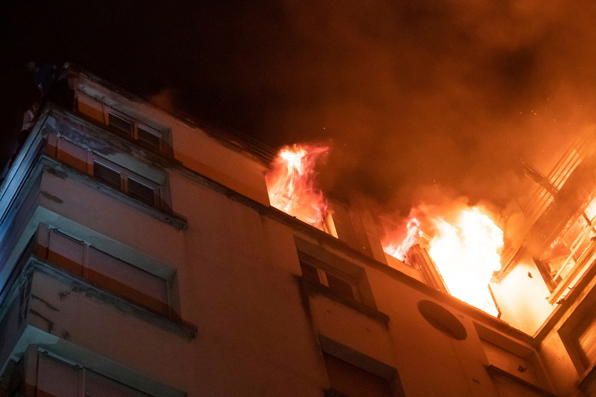 The Paris prosecutor says a woman has been detained in the initial investigation into the fire. (AP)