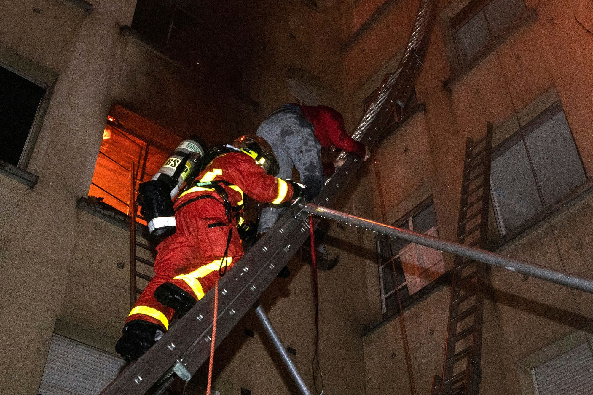 One person is in life-threatening condition and 30 others were injured in the blaze. (AP)