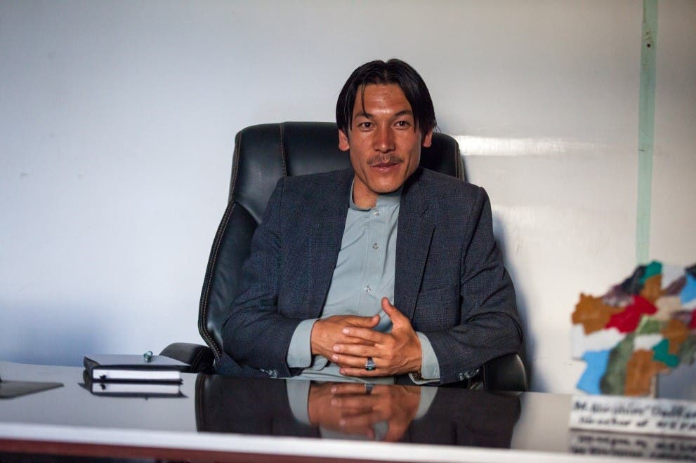 Mohammad Ibrahim Dadfar at his desk at the NEPA Office, Bamyan. (Georg Schaumberger)