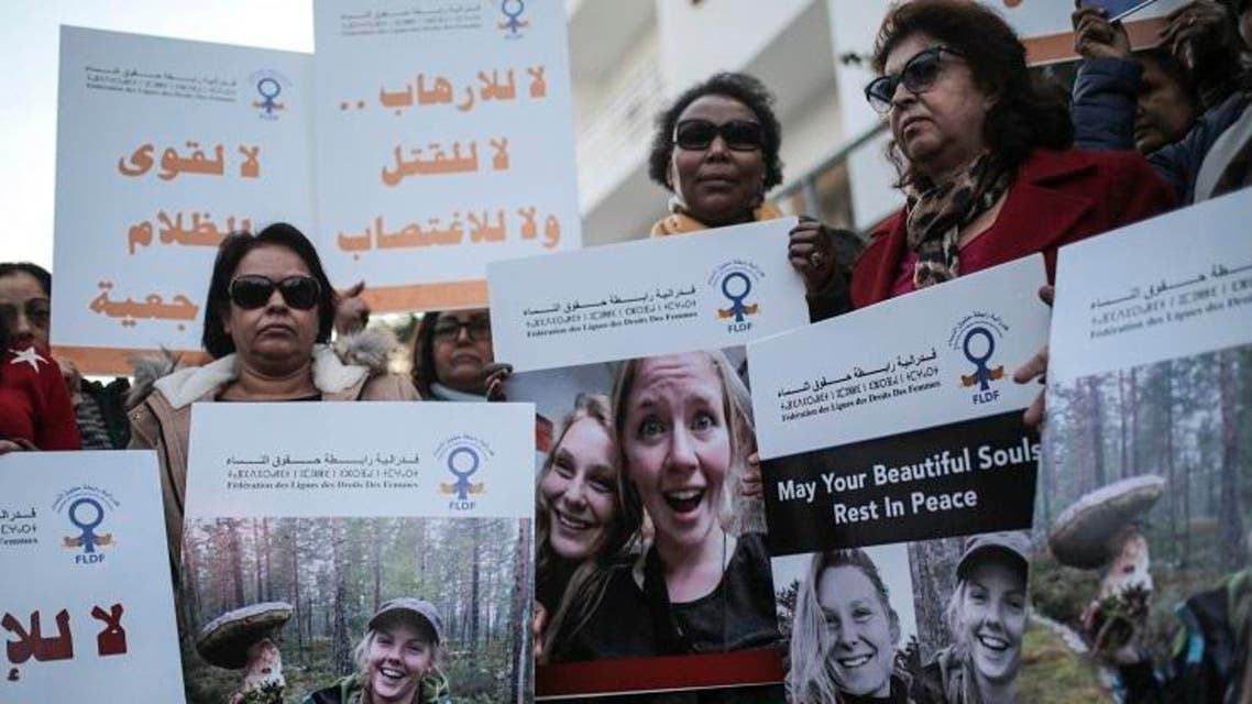 Moroccan women carry photos of Norwegian Maren Ueland and Danish Louisa Vesterager Jespersen, during a candlelight vigil in Rabat. (File photo: AFP)