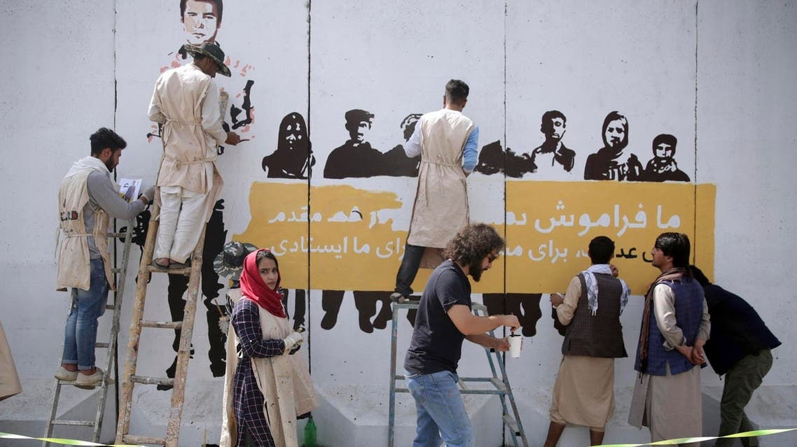 Artists paint mural of journalists killed in Afghanistan during 2018. (File photo: AP)