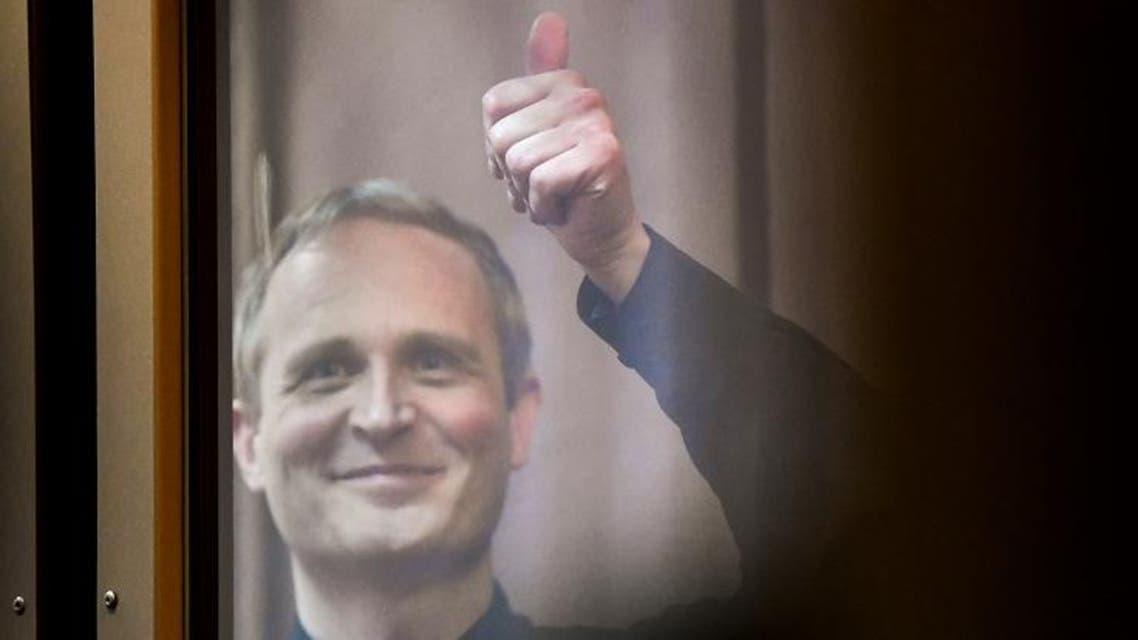 Dennis Christensen gestures from inside a defendants' cage. (AFP)