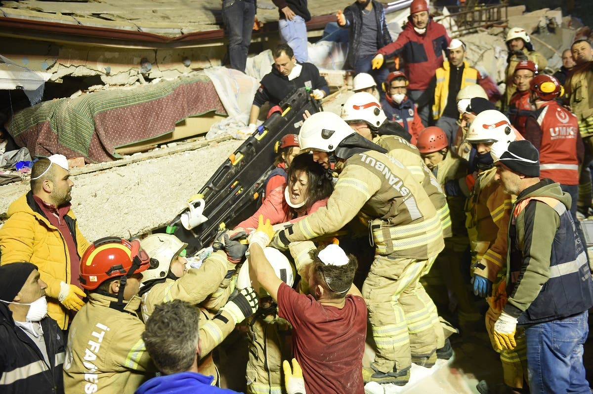 Turkish woman Arzu Tekgoz is rescued at the site of the building that collapsed in Istanbul's Kartal district. (AFP)