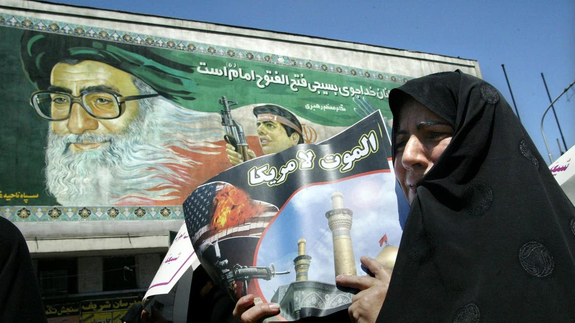 """An Iranian woman holding a picture reading """"Death to America"""" during anti-US demonstrationa in Tehran in 2004. (AFP)"""