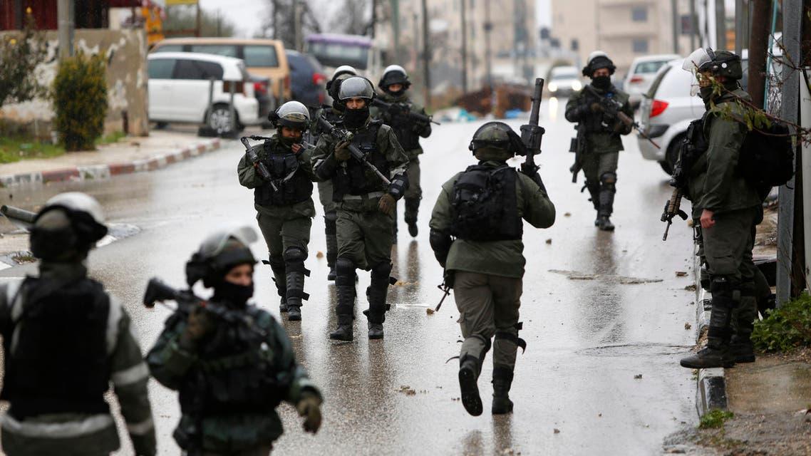Israeli forces during a raid in Ramallah on Jan. 9, 2019. (AP)