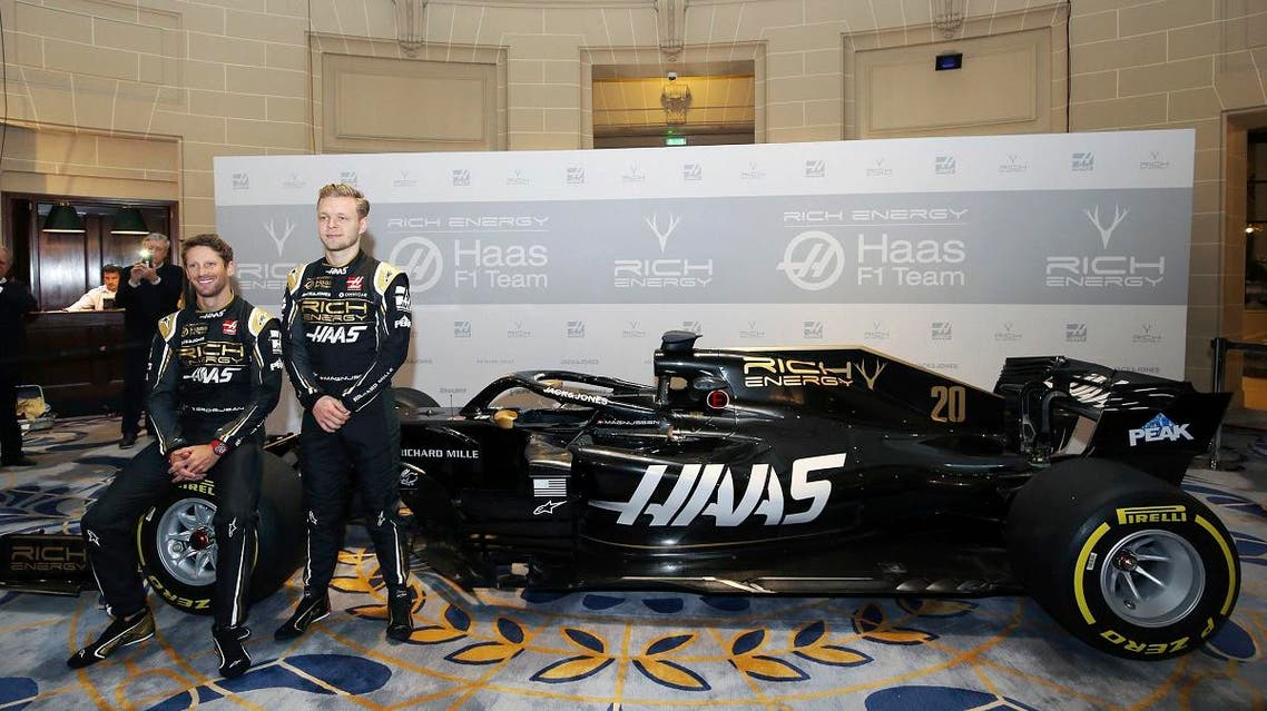 Drivers Romain Grosjean and Kevin Magnussen pose during the unveiling of their new Rich Energy Haas F1 Team 2019 car. (AP)