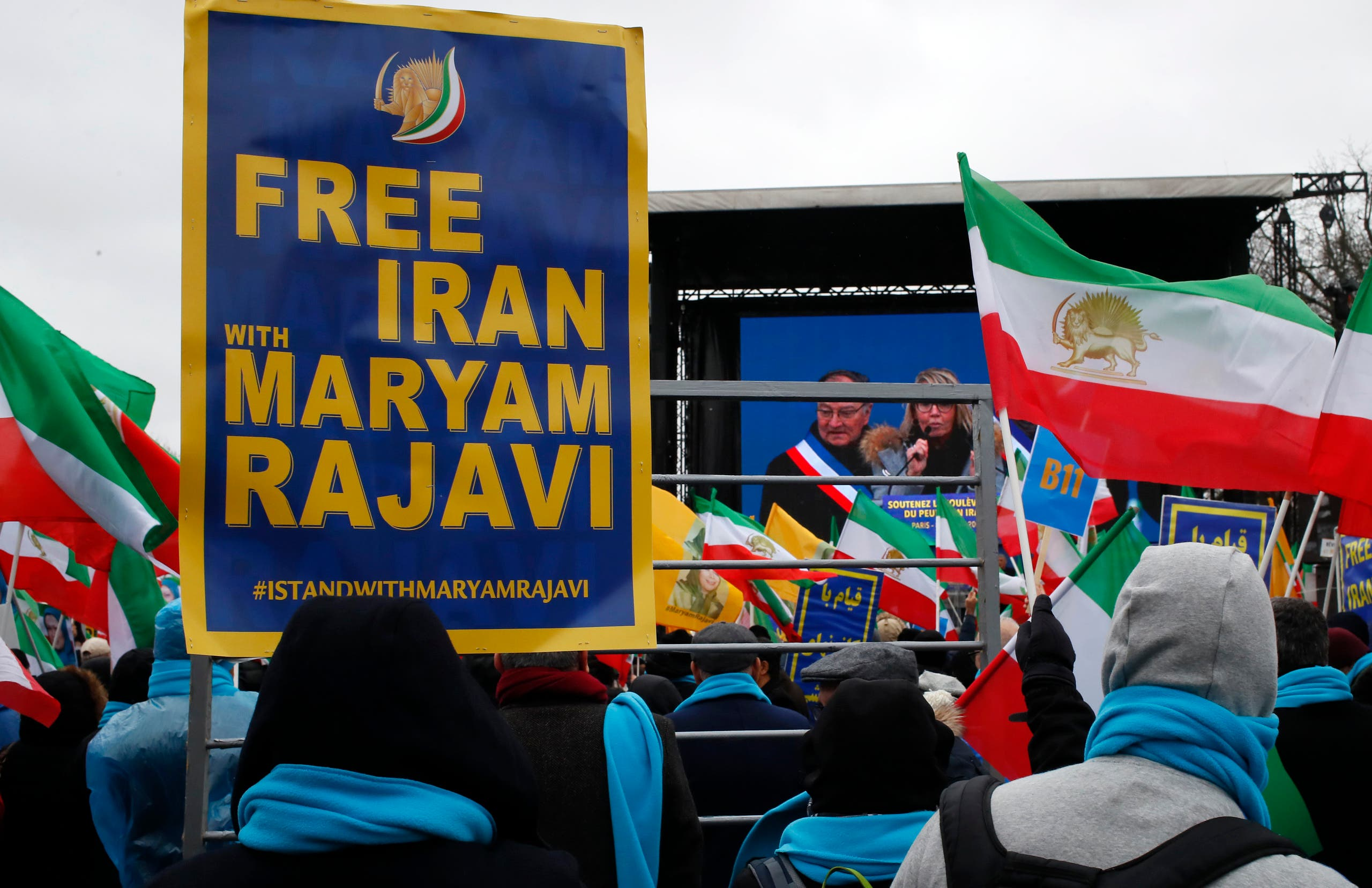 Supporters of Maryam Rajavi, the leader of the National Council of Resistance of Iran, demonstrate in Paris, Friday Feb.8, (AP)