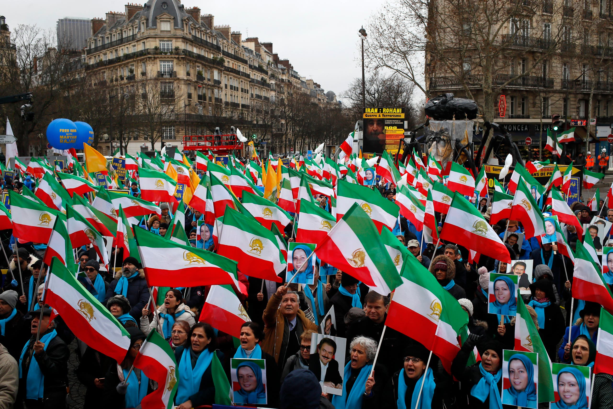 Supporters of Maryam Rajavi, the leader of the National Council of Resistance of Iran, demonstrate in Paris, Friday Feb.8, 2019 as Iran marks the 40th anniversary of its Islamic Revolution (AP)