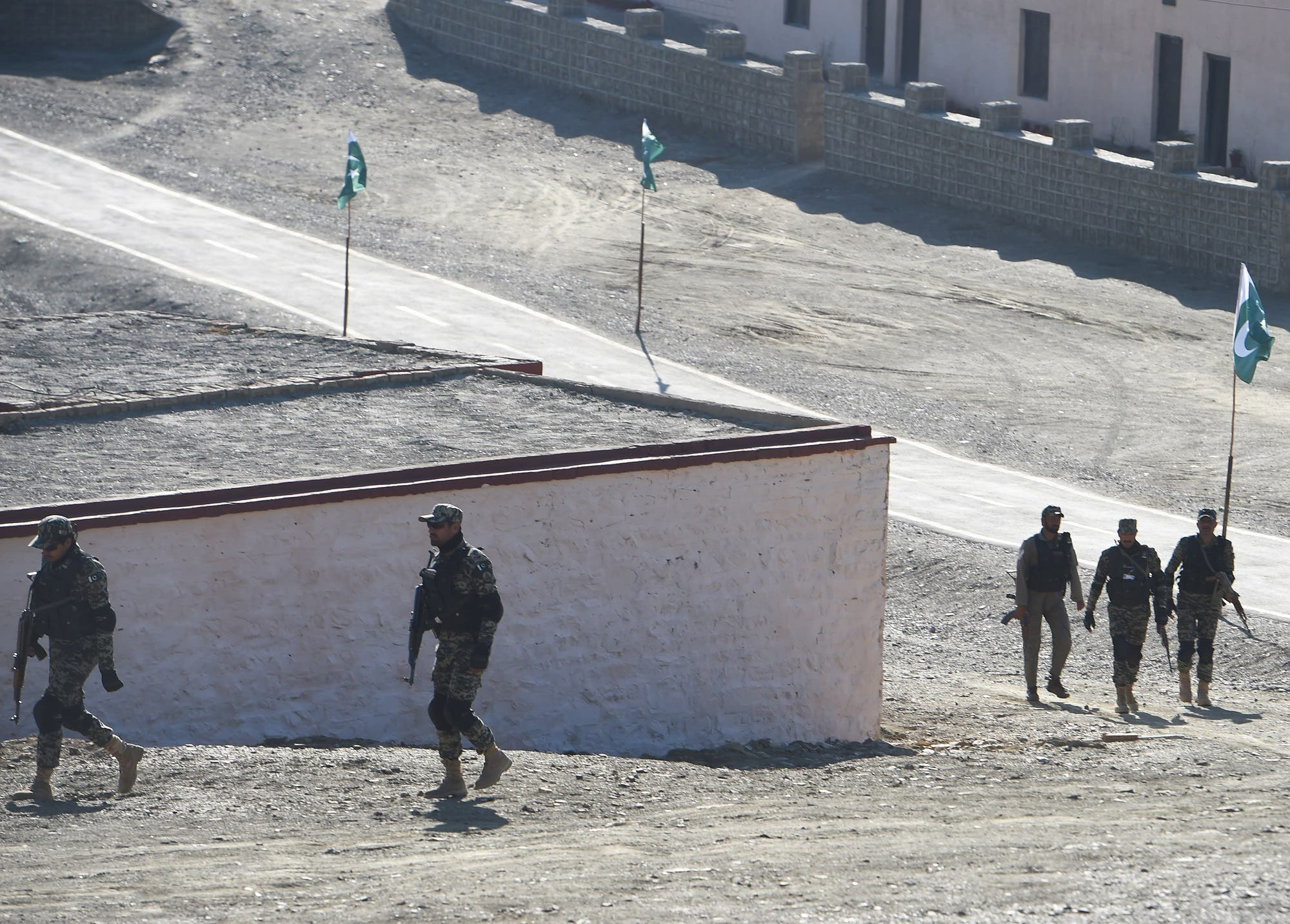 Pakistani army soldiers walk near a border terminal in Ghulam Khan, a town in North Waziristan, on the border between Pakistan and Afghanistan, on January 27, 2019. (AFP)