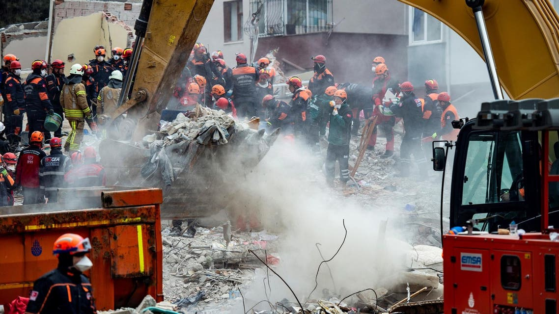 Rescue workers search the rubble of an eight-story building which collapsed in Istanbul. (AFP)