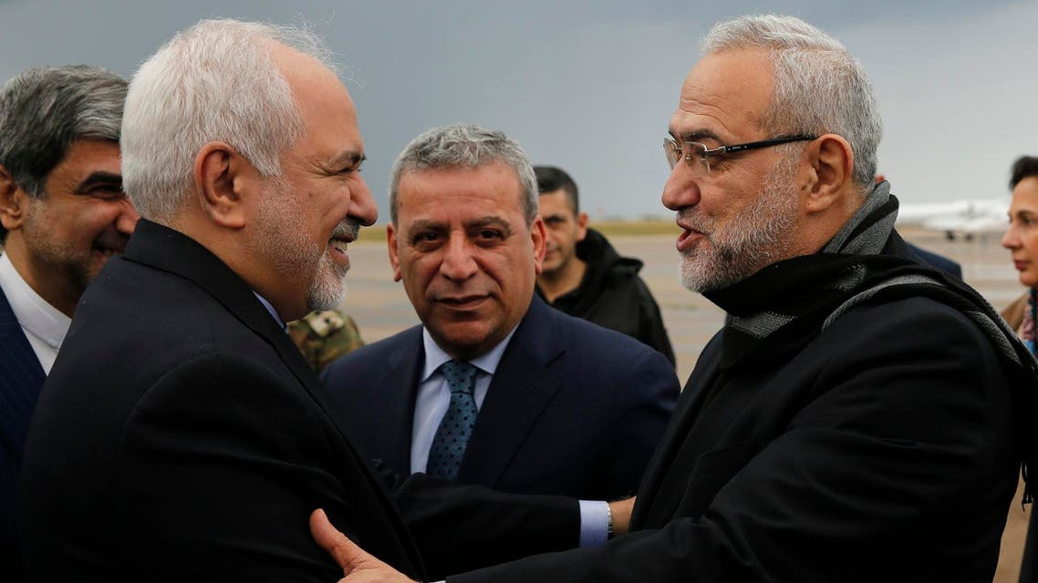 Mohammad Javad Zarif, is greeted by Lebanese Minister of State Parliamentary Affairs Mahmoud Qmati upon his arrival at Rafik Hariri Airport, in Beirut, on Sunday, February 10, 2019. (AP)