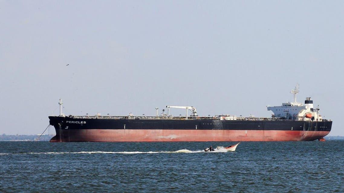 A fisherman's boat sails near the oil tanker Pericles while it is moored on Lake Maracaibo in Maracaibo, Venezuela January 29, 2019. REUTERS/Isaac Urrutia