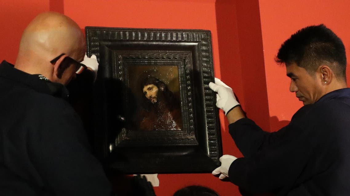 """Rembrandt's painting """"Study of the head and clasped hands of a young man as Christ in prayer"""", is put on display at the Louvre Abu Dhabi on February 9, 2019."""