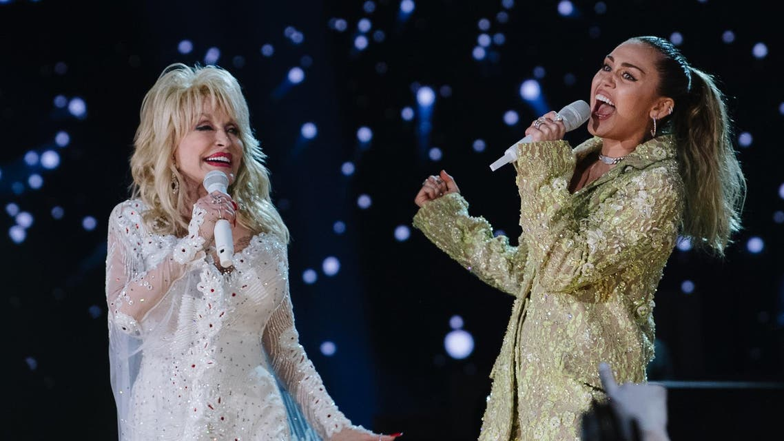 Dolly Parton and Miley Cyrus perform onstage at the 61st annual GRAMMY Awards. (AFP)