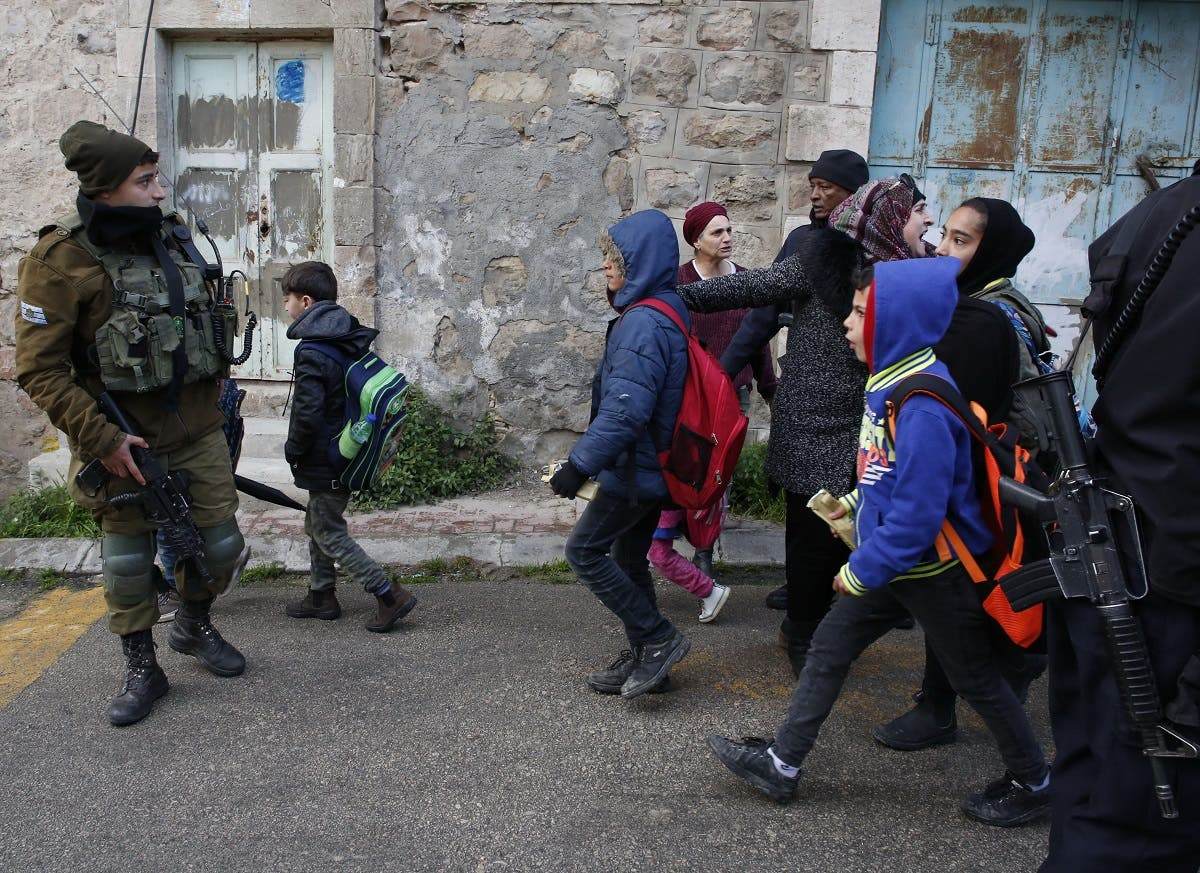 Palestinians pupils Hebron 3 (AFP)
