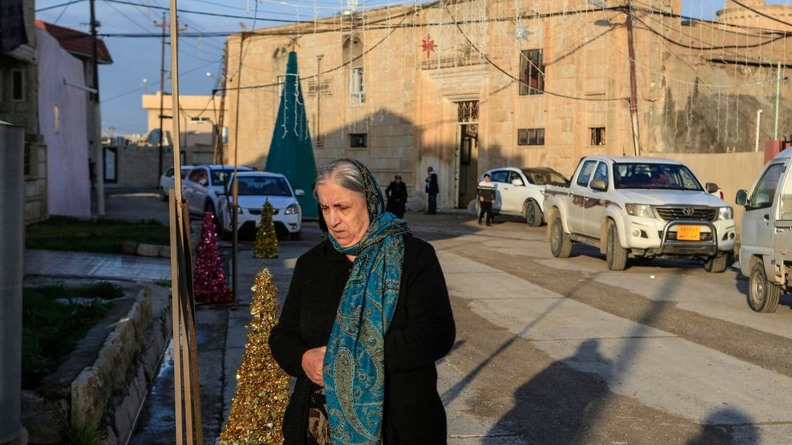 A woman walks in from of the Mart Shmony Orthodox Church in Bartella, Iraq, on January 18, 2019. (AP)