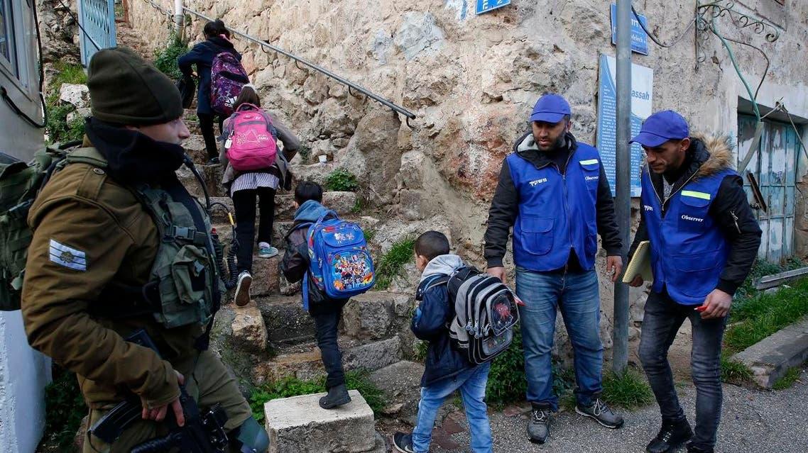 Palestinians pupils Hebron 1 (AFP)