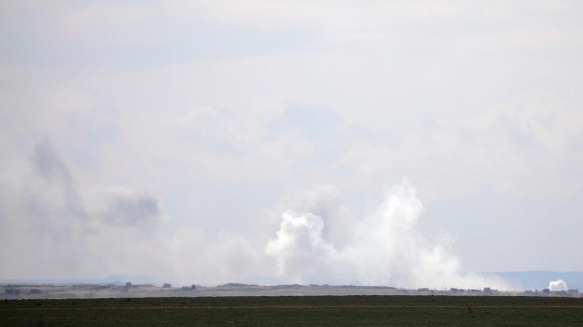 Plumes of smoke rise near Baghouz, Deir Al Zor province, Syria February 11, 2019. REUTERS/Rodi Said
