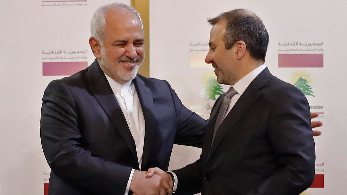 Lebanese Foreign Minister Gibran Bassil shakes hands with his Iranian counterpart Mohammad Javad Zarif