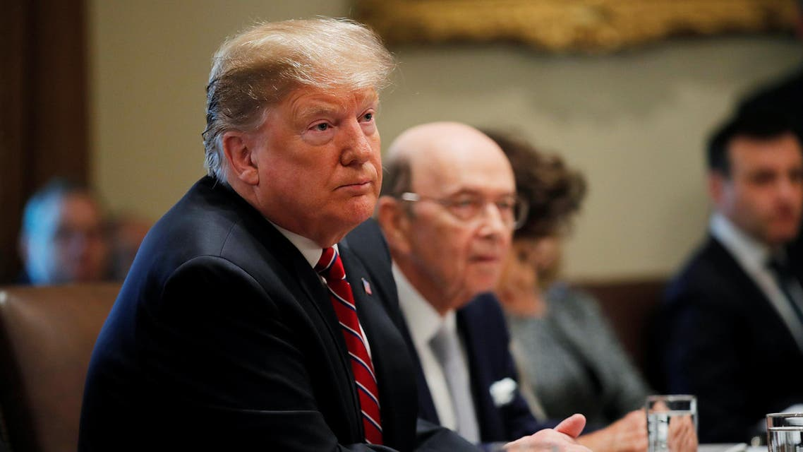U.S. President Donald Trump listens next to Commerce Secretary Wilbur Ross during a Cabinet meeting at the White House in Washington, U.S., February 12, 2019. REUTERS/Carlos Barria