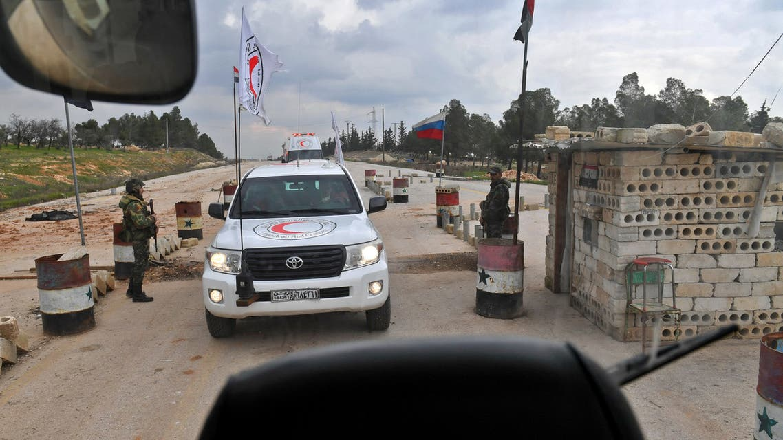 Pro-regime Syrian fighters sit in a Syrian Red Crescent vehicle during a prisoners' exchange between the Syrian regime forces and pro-Trukish rebels near the town of al-Bab in the northern Aleppo province on February 12, 2019. The British-based Syrian Observatory for Human Rights, which relies on sources in Syria, said 20 prisoners from each side were exchanged. Among those released by the regime, 11 women.