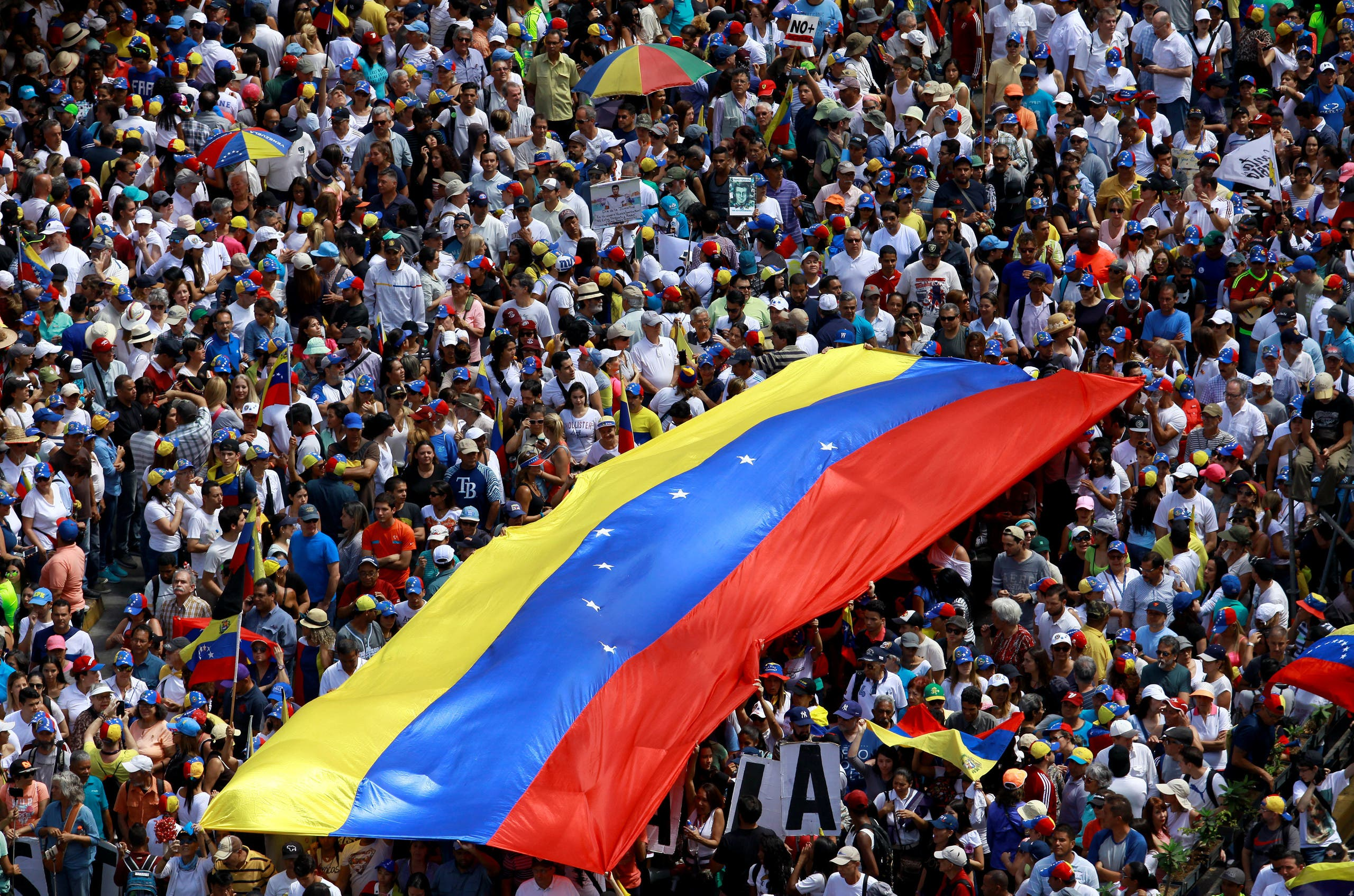 Opposition supporters take part in a rally to commemorate the Day of the Youth and to protest against Venezuelan President Nicolas Maduro's government in Caracas, Venezuela February 12, 2019. REUTERS/Adriana Loureiro NO RESALES. NO ARCHIVES