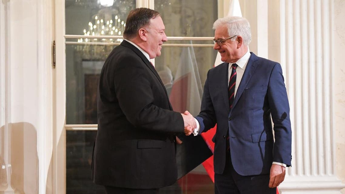 Polish Foreign Minister Jacek Czaputowicz (R) and US Secretary of State Mike Pompeo shake hands during a joint press conference on February 12, 2019, in Warsaw. (AFP)