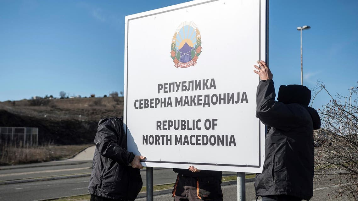 People set up a sign reading 'Republic of North Macedonia' at the Macedonia-Greece border on February 13, 2019. (AFP)