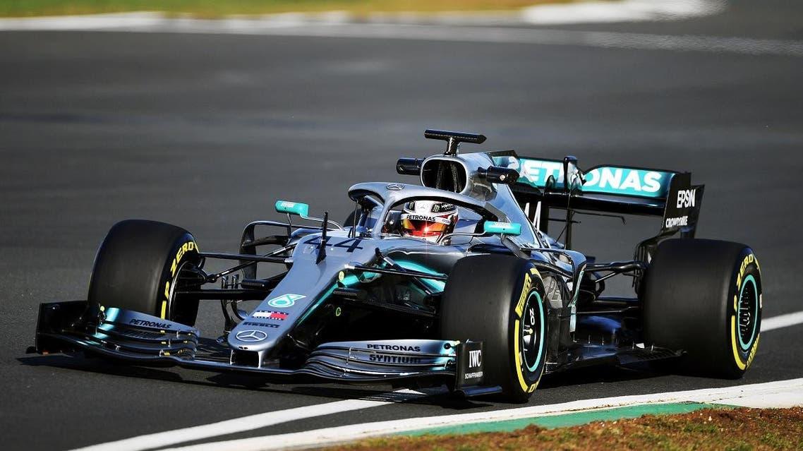 Mercedes' British driver Lewis Hamilton in the new Mercedes-AMG F1 W10 EQ Power+ formula one car. (AFP)