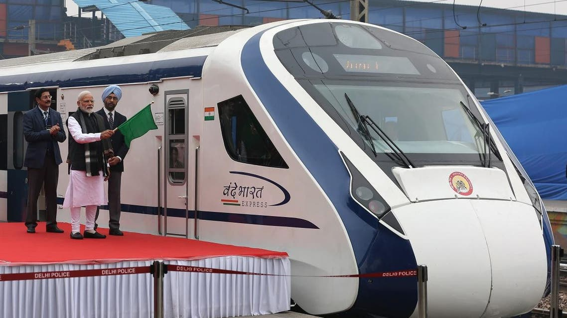 Indian Prime Minister Narendra Modi (2nd L) flags off India's first semi-high speed express train Vande Bharat Express at New Delhi Railway Station. (AFP)