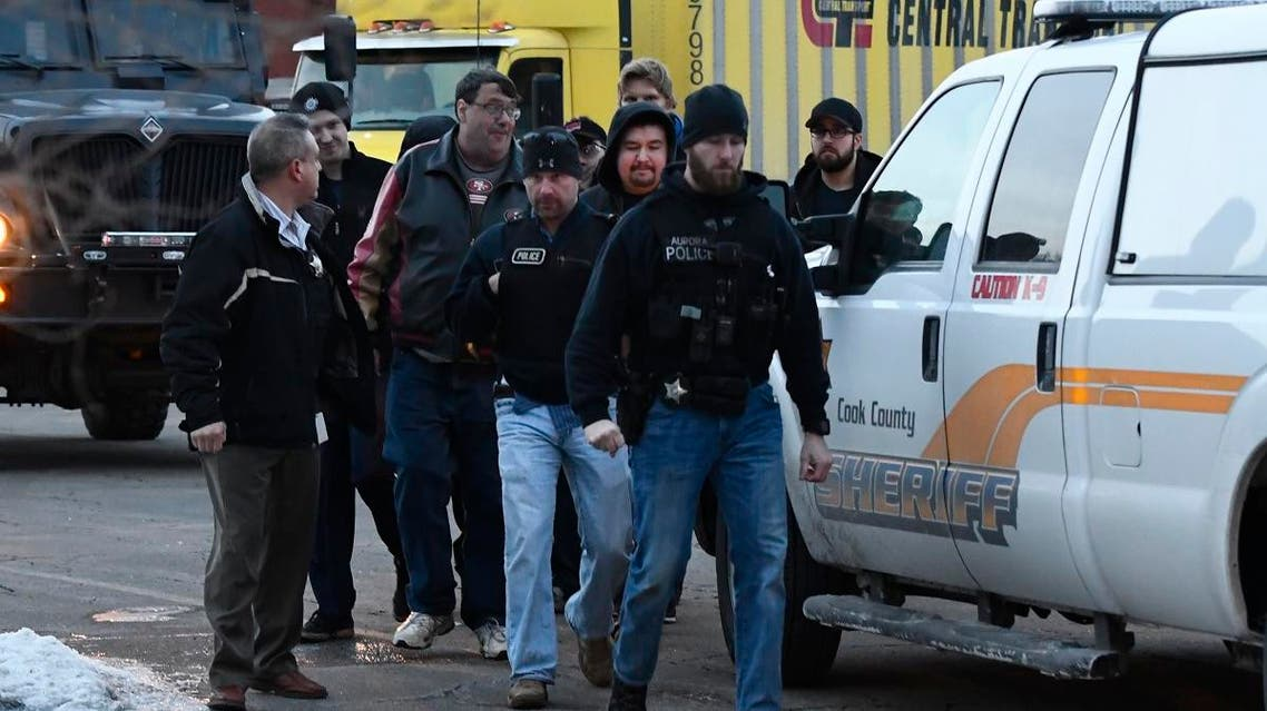 Employees are escorted from the scene of a shooting at a manufacturing company, Friday, Feb. 15, 2019. (AP)