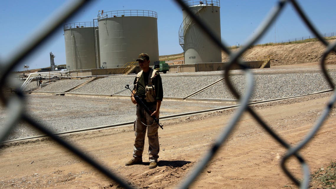 A security guard is seen at the Tawke oil refinery near the village of Zacho, in the autonomous Iraqi region of Kurdistan, on May 31, 2009. Iraq's self-ruled Kurdish region will begin exporting crude oil for the first time on June 1, piping up to 90,000 bpd to its neighbours, officials said. Initial exports will be around 40,000 barrels per day from the Taq Taq field in the province of Arbil and another 50,000 bpd from the Tawke field in Dohuk, company officials told AFP. AFP PHOTO/ALI AL-SAADI