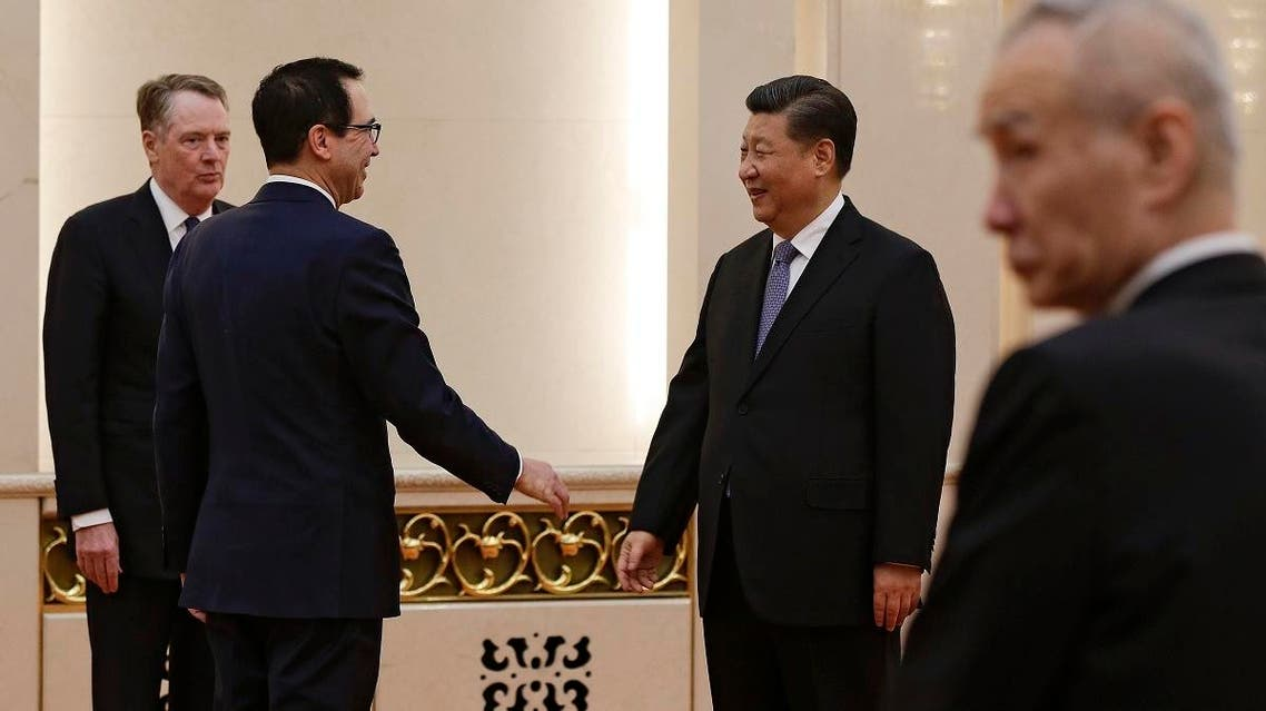 US Treasury Secretary Steven Mnuchin (2nd L) talks with Chinese President Xi Jinping as US Trade Representative Robert Lighthizer (L) and Chinese Vice Premier Liu He (R) look in Beijing on February 15, 2019. (AFP)