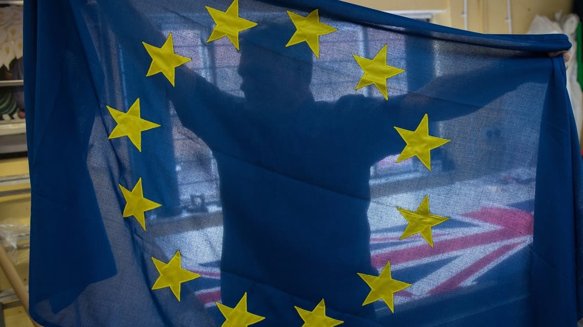 Andy Ormrod, the owner of Flying Colours Flagmakers Ltd, inspects a newly produced European Union (EU) flag in their premises in Knaresborough, northern England on February 7, 2019. At a flag-making workshop in northern England, orders for Unions Flags are flying while the EU's blue-and-yellow standard is proving less and less popular. Flying Colours, which makes flags for Britain's royal palaces, has seen EU flag orders drop by 90 percent since the country voted to leave the bloc in 2016.