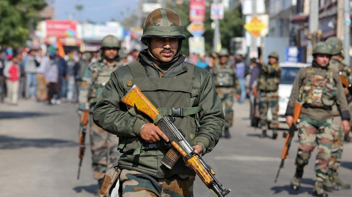 Indian Army soldiers patrol a street during a curfew in Jammu. (Reuters)