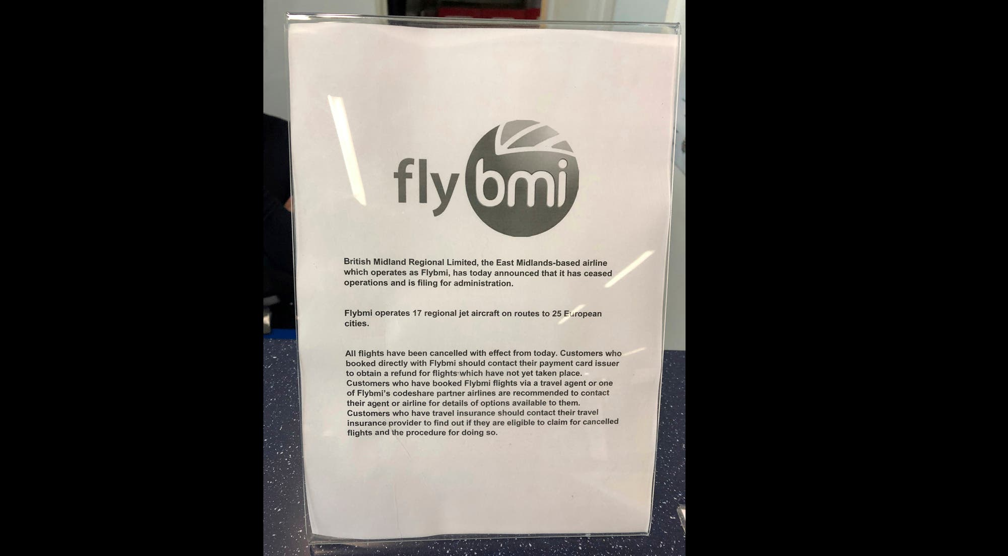 A notice informing passengers that flybmi flights have been cancelled following the collapse of the airline, at Bristol Airport in Bristol, England. (AP)