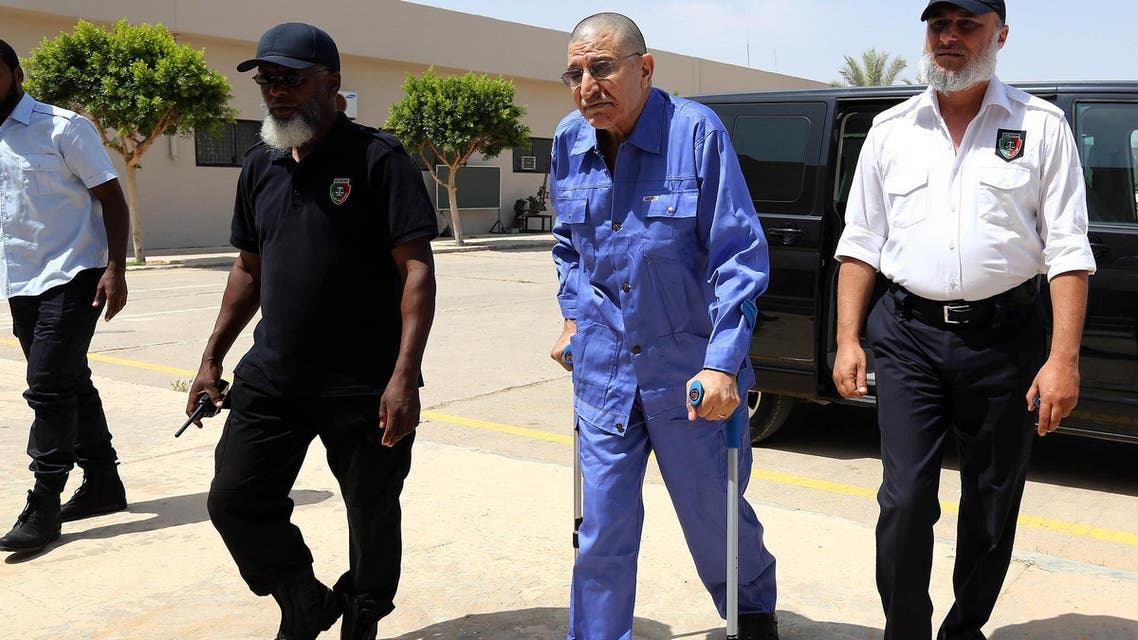 Former Libyan Foreign Intelligence Chief Bouzid Dorda arrives at the court for a hearing in his trial on June 25, 2013 in Tripoli. (AFP)