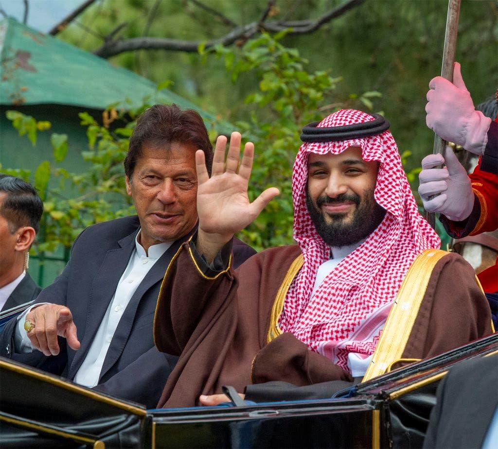 Saudi Crown Prince Mohammed bin Salman in open horse carriage with Pakistani PM Imran Khan (Bandar al-Jaloud)