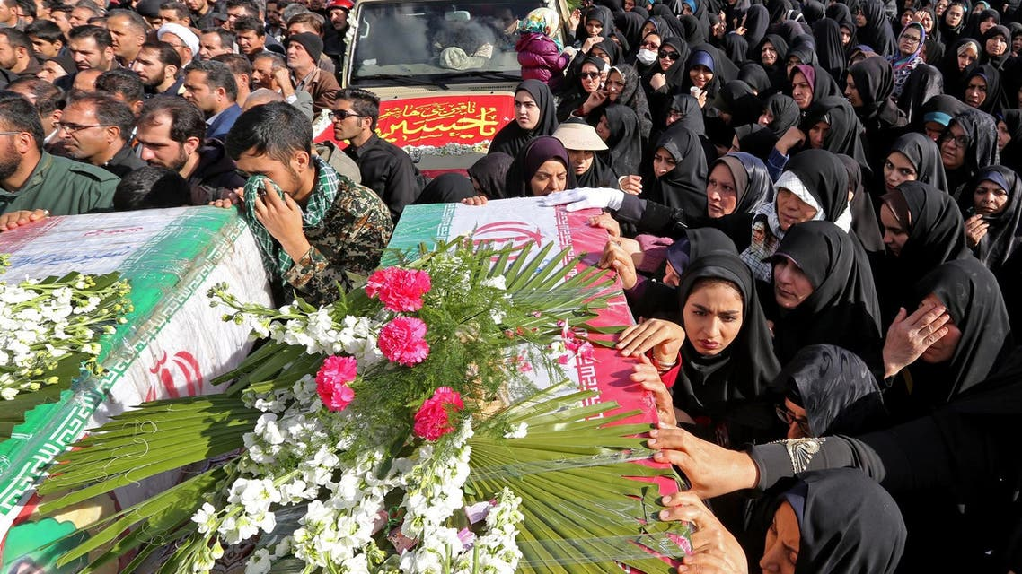 Iranians gather around the coffins of Revolutionary Guards who were killed in a suicide attack, during their funeral in Isfahan on February 16, 2019. (AFP)