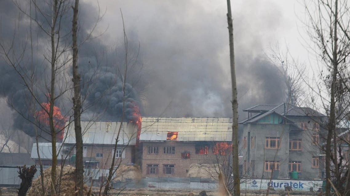 A house where suspected militants were holding up is seen in flames during a gun battle with Indian security forces in Pinglan village in south Kashmir's Pulwama district on February 18, 2019. (Reuters)