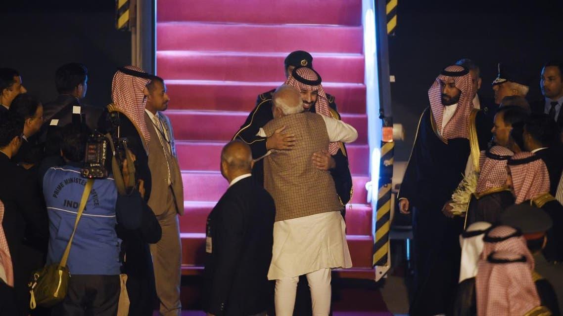 Indian Prime Minister Narendra Modi (front) welcomes Saudi Crown Prince Mohammed bin Salman