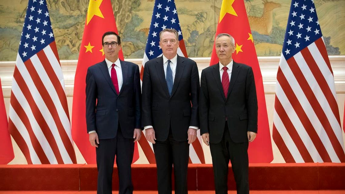 (L-R) US Treasury Secretary Steven Mnuchin, US Trade Representative Robert Lighthizer and Chinese Vice Premier Liu He pose for a group photo at the Diaoyutai State Guesthouse in Beijing on February 15, 2019. (AFP)