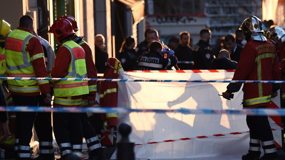 French police and emergency workers intervene in the Canebiere district in Marseille, after a man stabbed two passersby before being himself shot dead by police. (AFP)