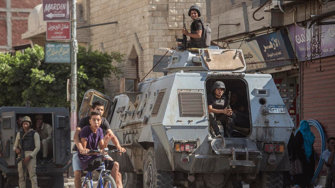 Egyptian policemen stand guarding a street in the North Sinai provincial capital of El-Arish, on July 26, 2018. (AFP)