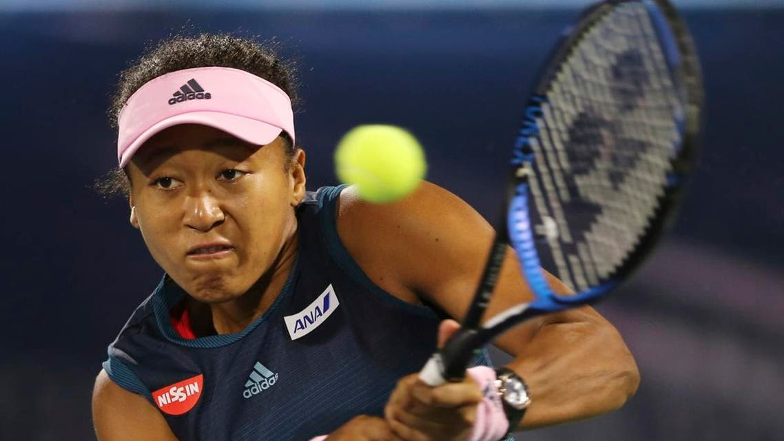 Naomi Osaka, of Japan, returns the ball to Kristina Mladenovic, of France, during a match of the Dubai Duty Free Tennis Championship in Dubai. (Reuters)