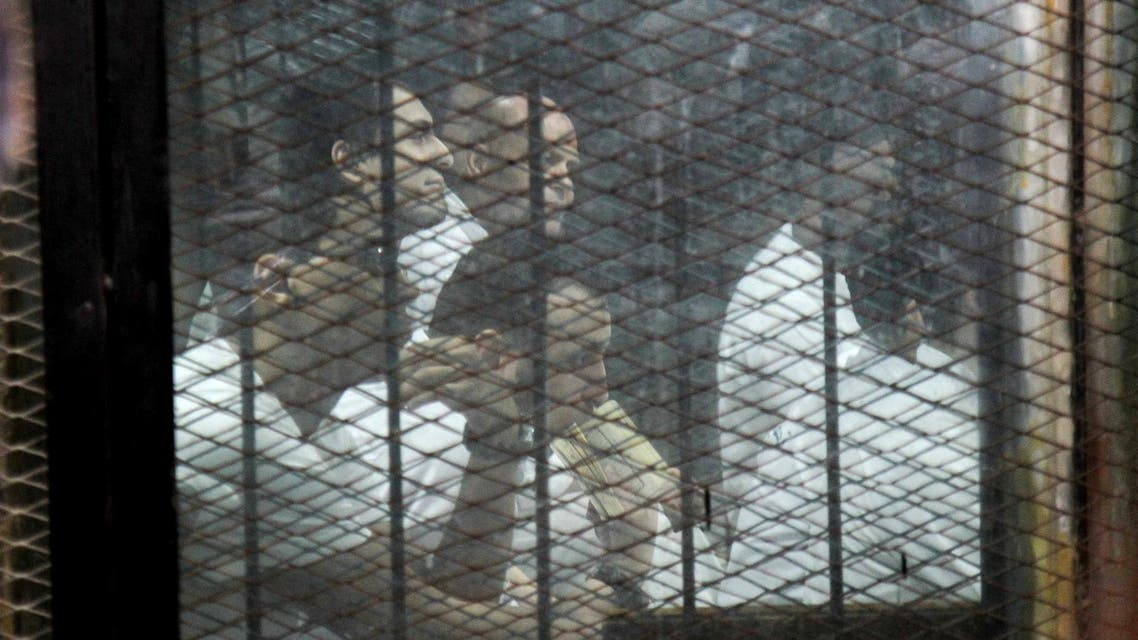 Egyptian defendants accused of forming a militant cell that assassinated Hisham Barakat in 2015, sit during a court hearing on June 17, 2017. (AFP)