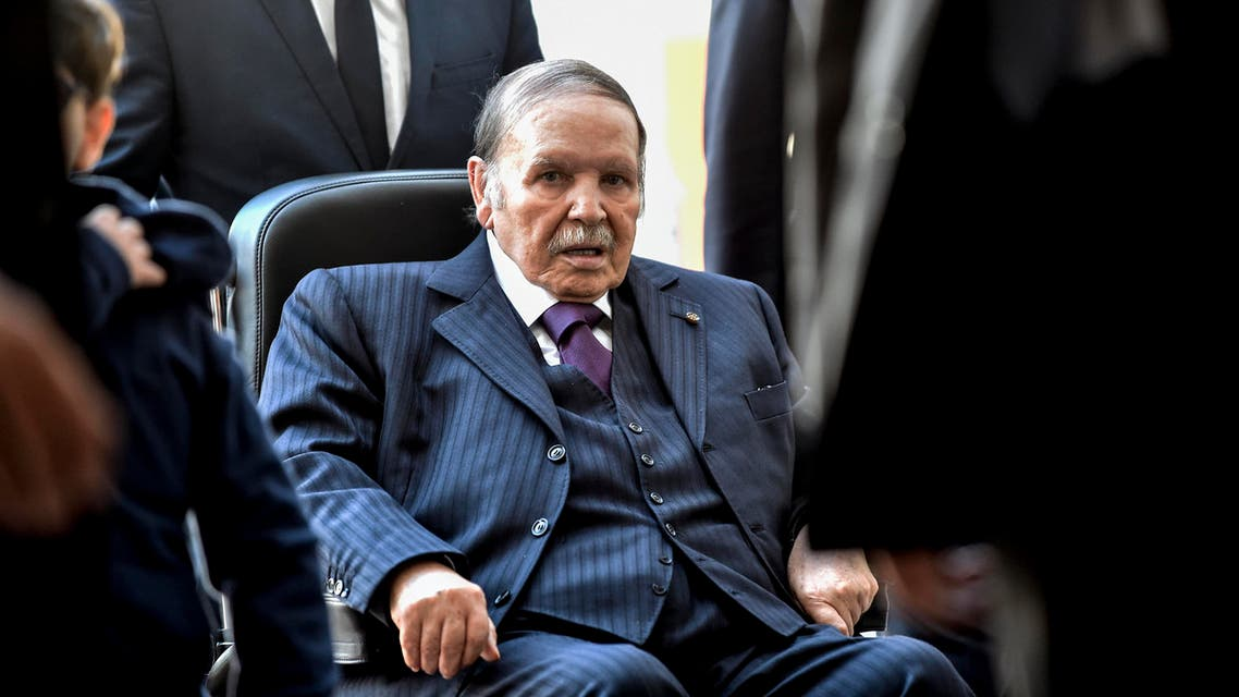 (FILES) In this file photo taken on November 23, 2017, Algerian President Abdelaziz Bouteflika is seen while voting at a polling station in the capital Algiers during polls for local elections. Algeria's ailing President Abdelaziz Bouteflika will seek a fifth term in April elections, the country's official APS news agency said on February 10. The 81-year-old head of state, in power since 1999, announced his candidacy in a message to the nation sent to the agency, said APS, which will release it later in the day.