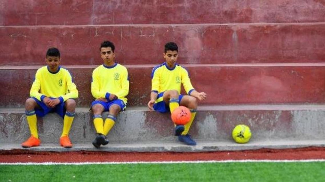 Young cancer patients warming up before a game of soccer in Gaza City. (Reuters)