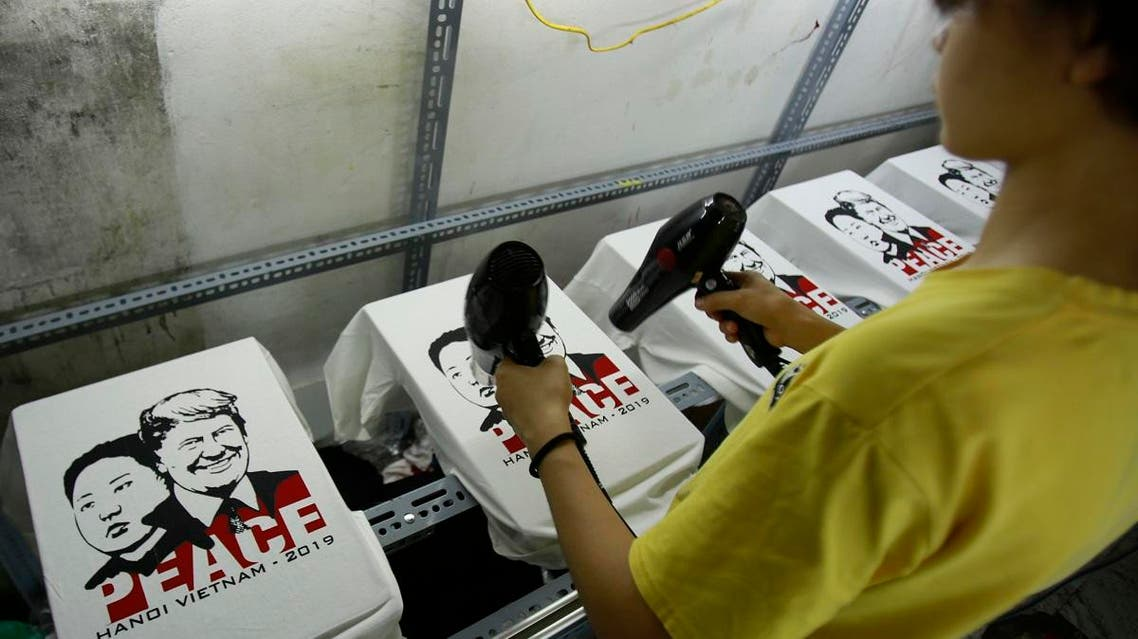 worker blow-dries fresh printed t-shirts with portraits of U.S. President Donald Trump, right on shirt, and North Korean leader Kim Jong Un, at a custom t-shirt shop in Hanoi, Vietnam. (AP)